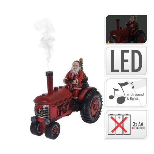 Led Joulupukki traktorin kyydissä